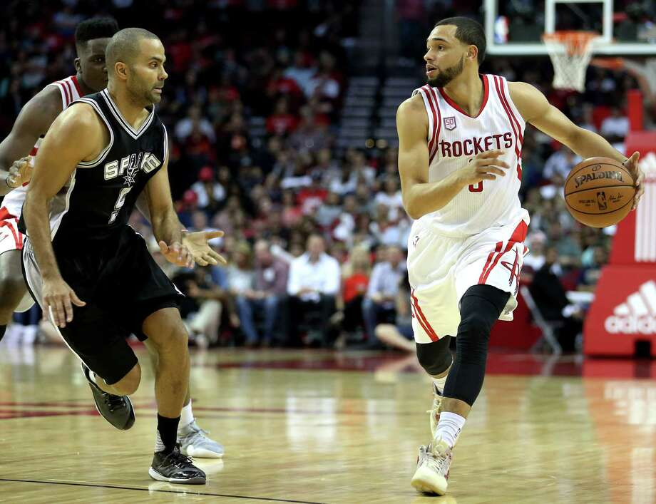 Houston Rockets guard Tyler Ennis (6) dribbles while San Antonio Spurs guard Tony Parker (9) is guarding him during the second half of the game Saturday, Nov. 12, 2016, in Houston. The Rockets lost to the Spurs 106-100. Photo: Yi-Chin Lee, Houston Chronicle / © 2016  Houston Chronicle
