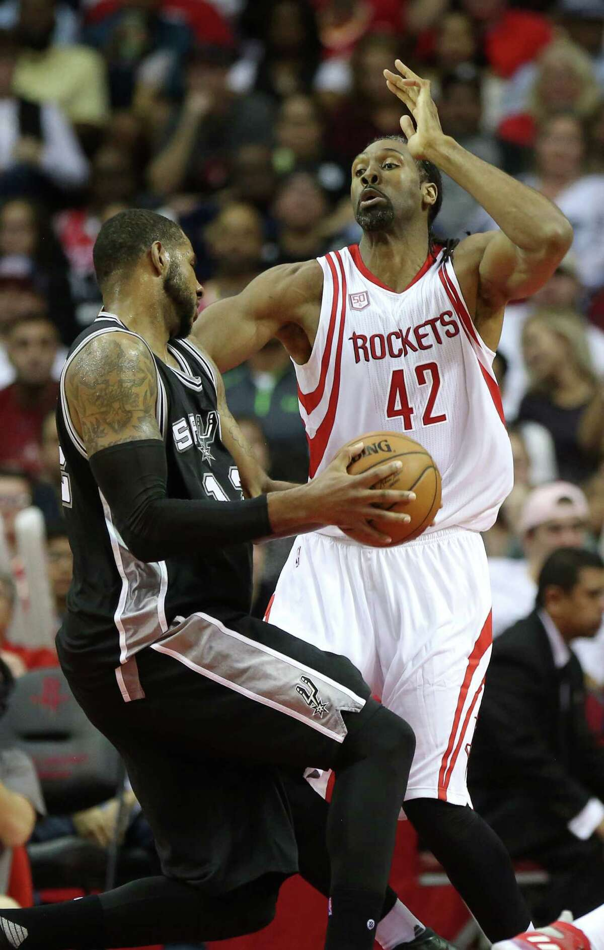 Houston Rockets center Nene Hilario (42) guarding San Antonio Spurs forward LaMarcus Aldridge (12) during the second half of the game Saturday, Nov. 12, 2016, in Houston. The Rockets lost to the Spurs 106-100.
