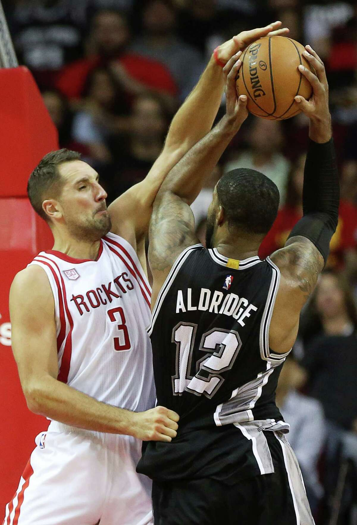 Houston Rockets forward Ryan Anderson (3) fouls on San Antonio Spurs forward LaMarcus Aldridge (12) during the second half of the game Saturday, Nov. 12, 2016, in Houston. The Rockets lost to the Spurs 106-100.