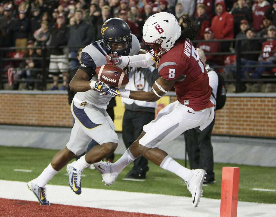 California cornerback Josh Drayden, left, breaks up a pass intended for Washington State wide receiver Tavares Martin Jr. (8) during the first half of an NCAA college football game in Pullman, Wash., Saturday, Nov. 12, 2016. (AP Photo/Young Kwak) Photo: Young Kwak, Associated Press