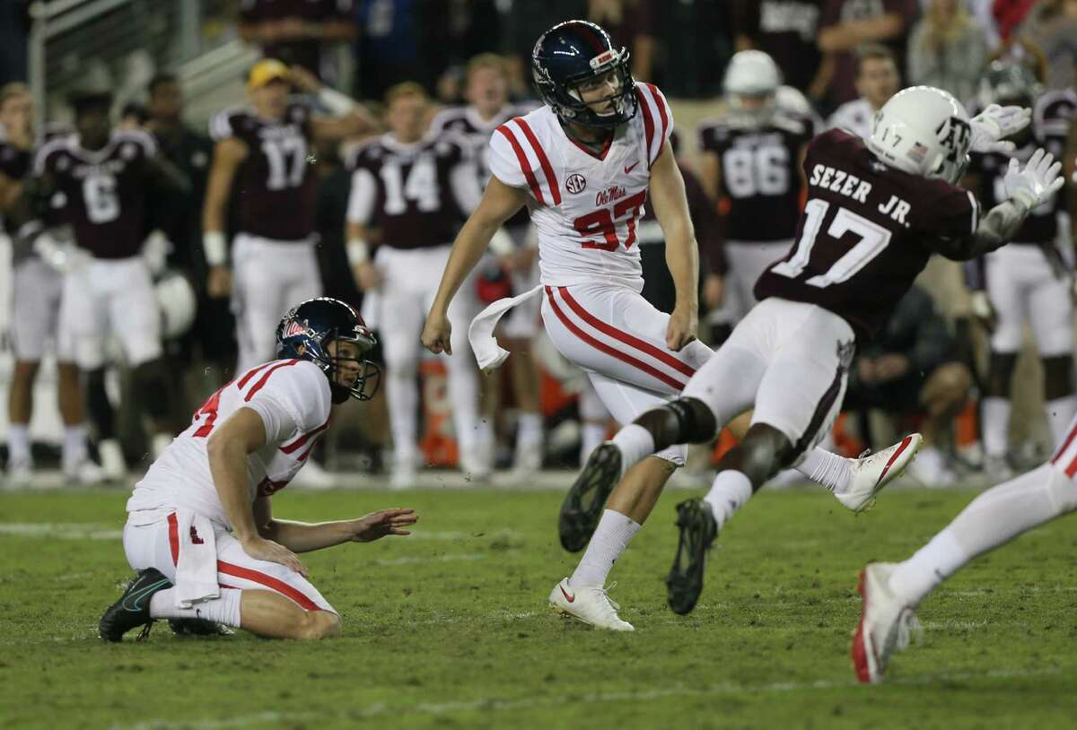 COLLEGE STATION, TX - NOVEMBER 12: Gary Wunderlich #97 of the Mississippi Rebels kicks a 39 yard field goal as Alex Sezer #17 of the Texas A&M Aggies misses on the block to take the lead 29-28 with 37 seconds to go in the game against the Texas A&M Aggies at Kyle Field on November 12, 2016 in College Station, Texas.