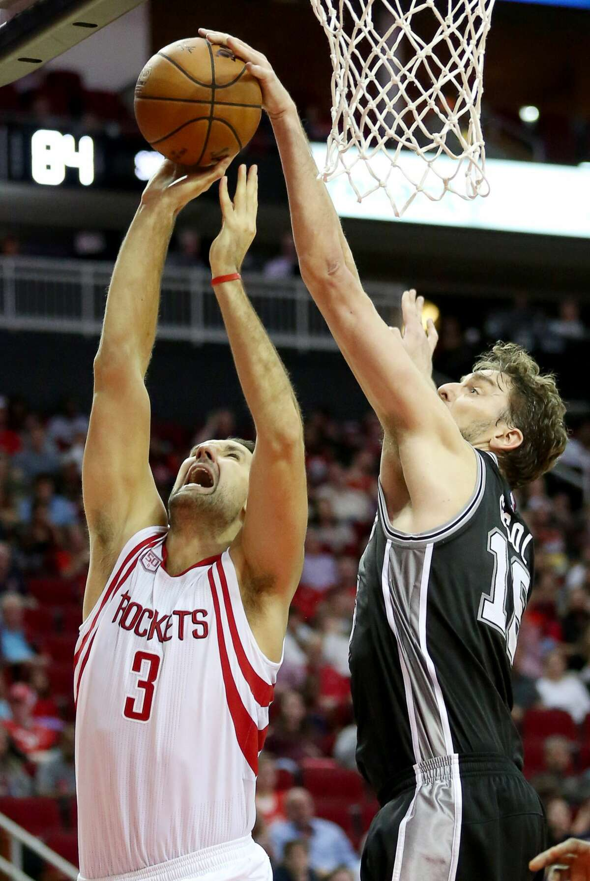 Houston Rockets forward Ryan Anderson (3) is fouled by San Antonio Spurs center Pau Gasol (16) under the basket during the second half of the game Saturday, Nov. 12, 2016, in Houston. The Rockets lost to the Spurs 106-100. ( Yi-Chin Lee / Houston Chronicle )