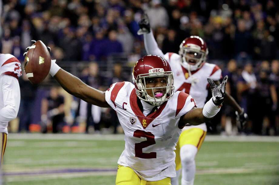USC defensive back Adoree' Jackson rejoices after intercepting a Washington pass during the second half. Photo: Elaine Thompson, STF / Copyright 2016 The Associated Press. All rights reserved.