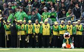 EUGENE, OR - NOVEMBER 12: 'Puddles', the Oregon Ducks mascot, sits in front of the Oregon band as time winds down during the second quarter of the game at Autzen Stadium on November 12, 2016 in Eugene, Oregon. (Photo by Steve Dykes/Getty Images)