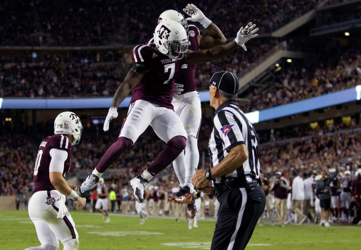 Texas A&M running back Keith Ford (7) celebrates a touchdown with wide receiver Speedy Noil (2) during the first quarter of an NCAA college football game against Mississippi, Saturday, Nov. 12, 2016, in College Station, Texas. (AP Photo/Sam Craft)