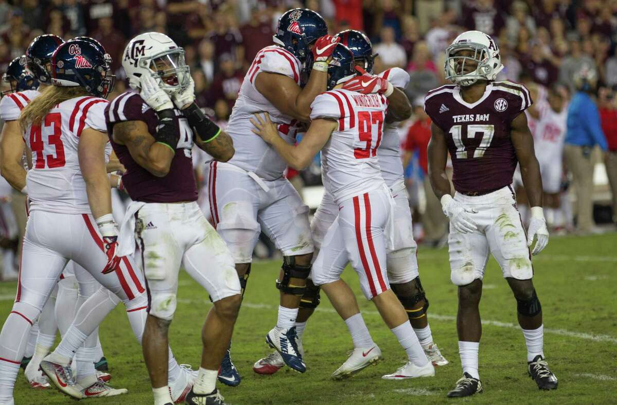 Mississippi kicker Gary Wunderlich (97) is swarmed by teammates after making the game-winning field goal with 37 seconds left to leave Alex Sezer Jr. (17) and the No. 8 Aggies staring at a 29-28 setback Saturday.