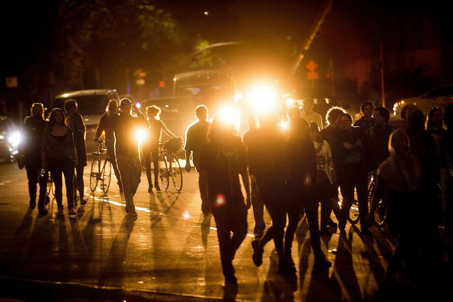 Approximately 50 protesters against president-elect Donald Trump march along Martin Luther King Jr. Way near the Ashby BART station on Saturday, Nov. 12, 2016, in Oakland. Photo: Noah Berger, Special To The Chronicle