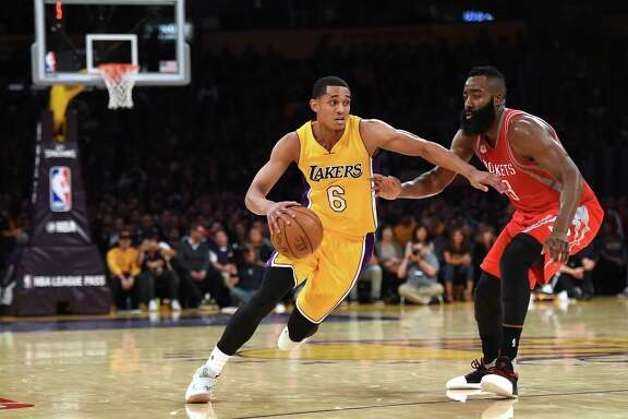 LOS ANGELES, CA - OCTOBER 26:  Jordan Clarkson #6 of the Los Angeles Lakers drives on James Harden #13 of the Houston Rockets during a 120-114 season opening Laker win at Staples Center on October 26, 2016 in Los Angeles, California.  NOTE TO USER: User expressly acknowledges and agrees that, by downloading and or using this photograph, User is consenting to the terms and conditions of the Getty Images License Agreement.