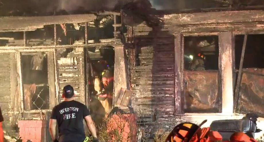 Two elderly Houstonians made it safety after a house went up in flames in the Third Ward, authorities said.  Firefighters arrived on scene just after 5:30 a.m. Sunday to find smoke and flames pouring out of the single-story wood-frame home on Lucinda. Photo: Metro Video