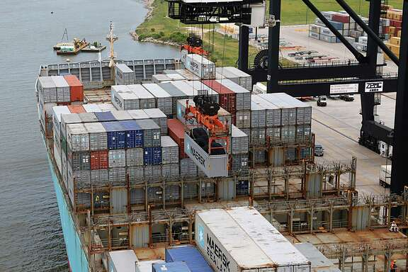 A crane unloads a container from a ship at the Port of Houston Authority, Bayport Container Terminal on June 22, 2016, in Seabrook.  (James Nielsen / Houston Chronicle)