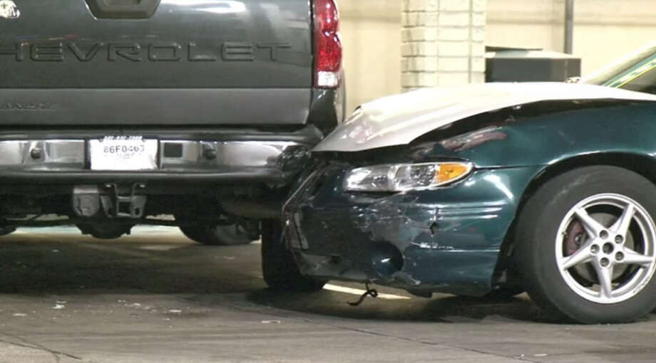 After the victim fled the scene, he collapsed and crashed into a parked pickup truck at a local gas station. Photo: Metro Video
