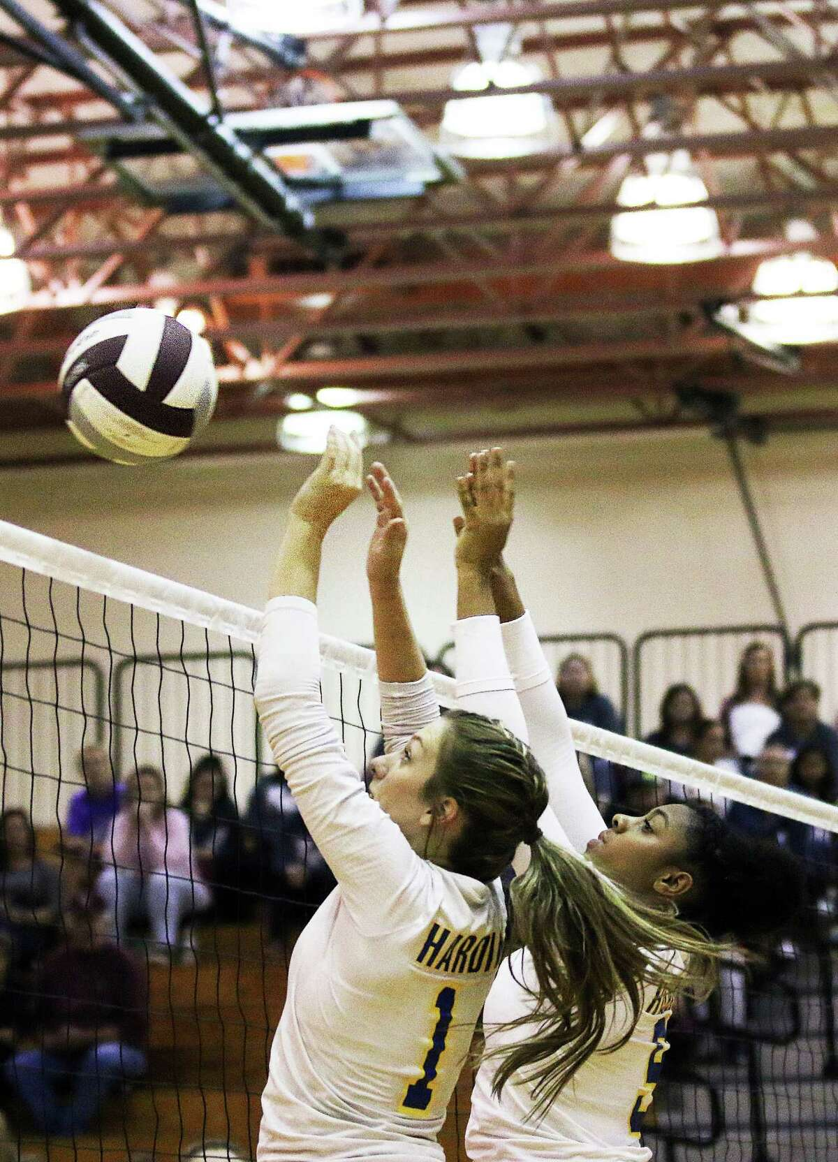 Shayla Fisher and NaÂ?'Kendra Ellis go up to try and block a kill by the Brahmaettes in the Regional Quarterfinal volleyball playoffs.