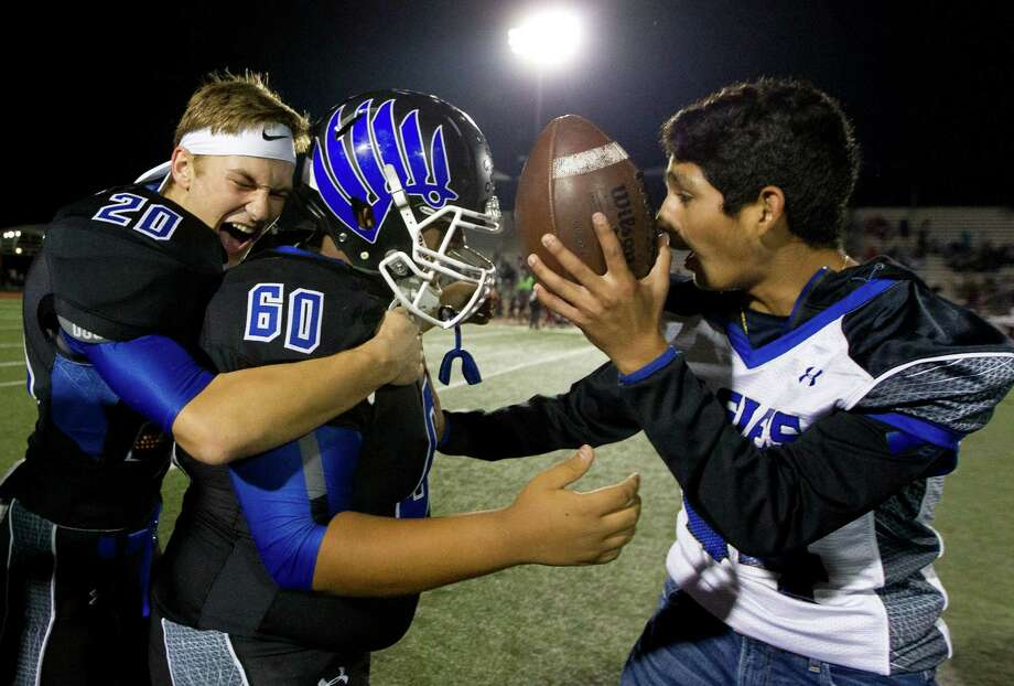 New Caney's Mason Vaughn (20) hugs kicker Jason Gonzalez (60) as he is presented with the game ball after kicking 26-yard field goal to give the Eagles a 31-28 triple-overtime win over Beaumont Central in a Region III-5A Division 1 bi-district high school football game at Turner Stadium Saturday, Nov. 12, 2016, in Humble. Photo: Jason Fochtman, Staff Photographer / Houston Chronicle