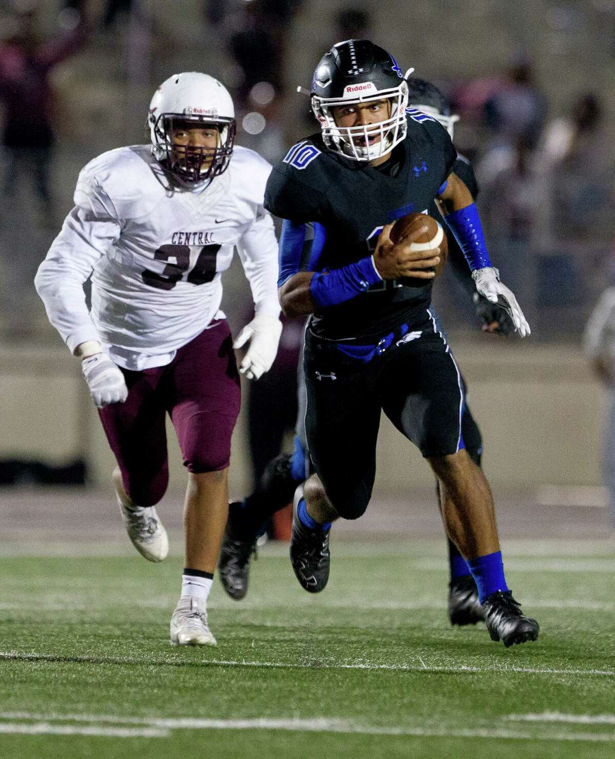New Caney quarterback Jordan Cooper (10) runs for a first down during the third overtime period of a Region III-5A Division 1 bi-district high school football game at Turner Stadium Saturday, Nov. 12, 2016, in Humble. New Caney defeated Beaumont Central 31-28 in triple-overtime.