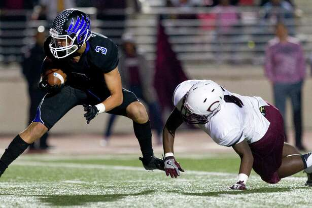 New Caney wide receiver Eli Akin (3) gets past Beaumont Central defensive back James Richards (42) for a 13-yard touchdown during the second overtime period of a Region III-5A Division 1 bi-district high school football game at Turner Stadium Saturday, Nov. 12, 2016, in Humble. New Caney defeated Beaumont Central 31-28 in triple-overtime.