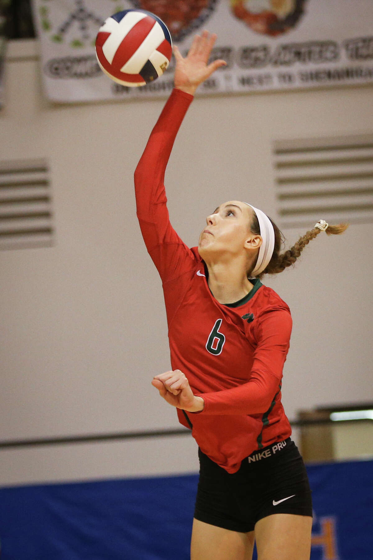 The Woodlands' Courtney Heiser (6) hits the ball during the varsity volleyball game against Oak Ridge on Saturday, Nov. 12, 2016, at Johnson Coliseum in Huntsville, Texas. (Michael Minasi / Chronicle)