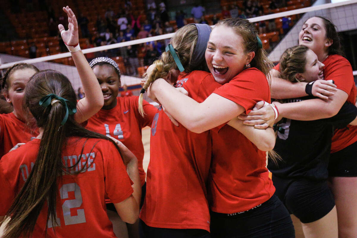 Oak Ridge's Hailey Lohnes (15) and Molly Russell (6) hug after the Lady War Eagles win the varsity volleyball match against The Woodlands on Saturday, Nov. 12, 2016, at Johnson Coliseum in Huntsville, Texas. (Michael Minasi / Chronicle)