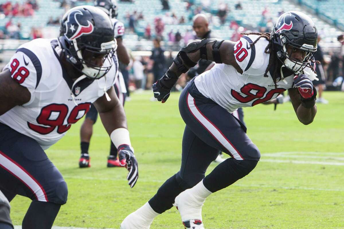 Houston Texans defensive ends Jadeveon Clowney (90) and D.J. Reader (98) warm up before an NFL football game between the Texans and the Jacksonville Jaguars at Everbank Field on Sunday, Nov. 13, 2016, in Jacksonville.