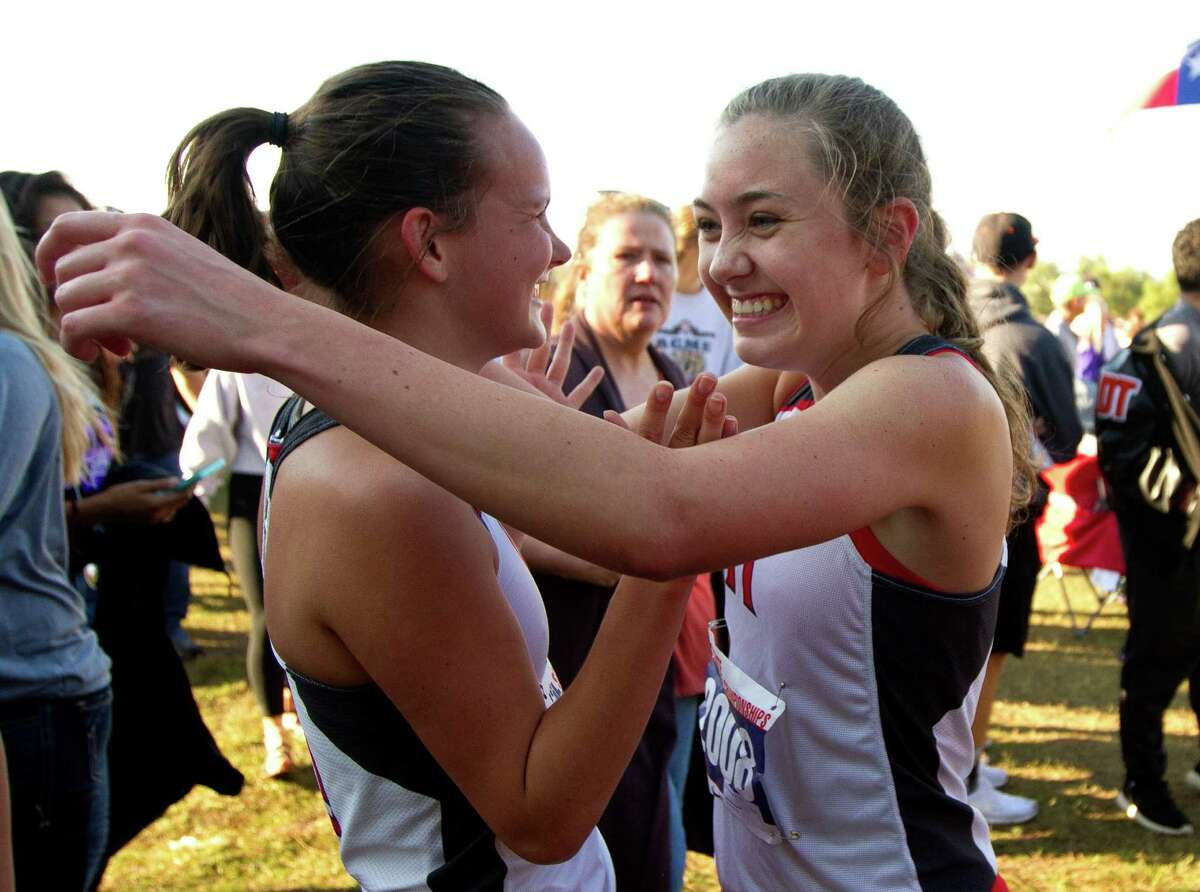 Mya Van Meter, of Huffman, gets a hug from teammate Maggie Shropshire after competing in the Class 4A girls race during the UIL state cross country championships at Old Settlers Park Saturday, Nov. 12, 2016, in Round Rock.