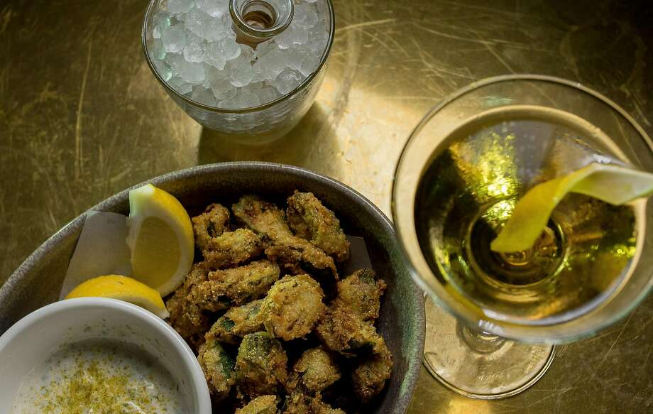 Fried okra with the 1st Ward cocktail at Elite Cafe on Fillmore in S.F. Photo: John Storey, Special To The Chronicle
