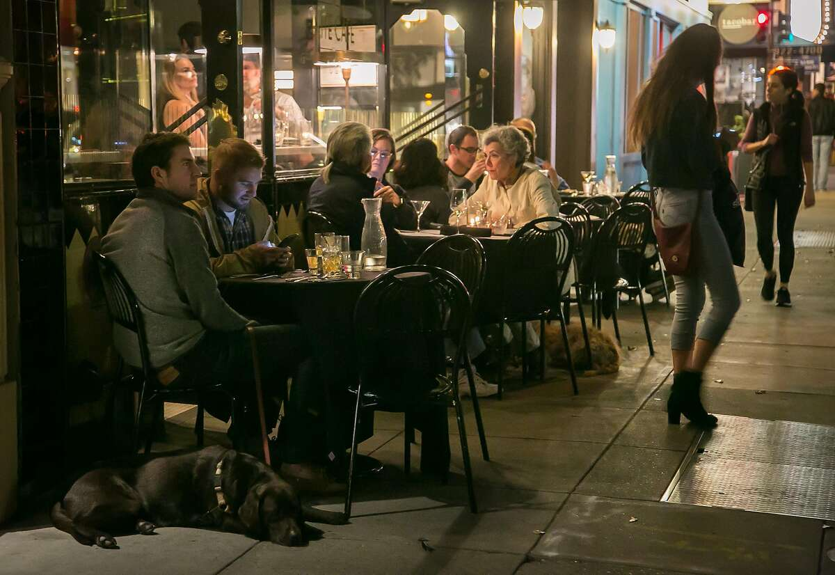 Popel have dinner on the sidewalk at the Elite Cafe in San Francisco, Calif. on November 12th, 2016.