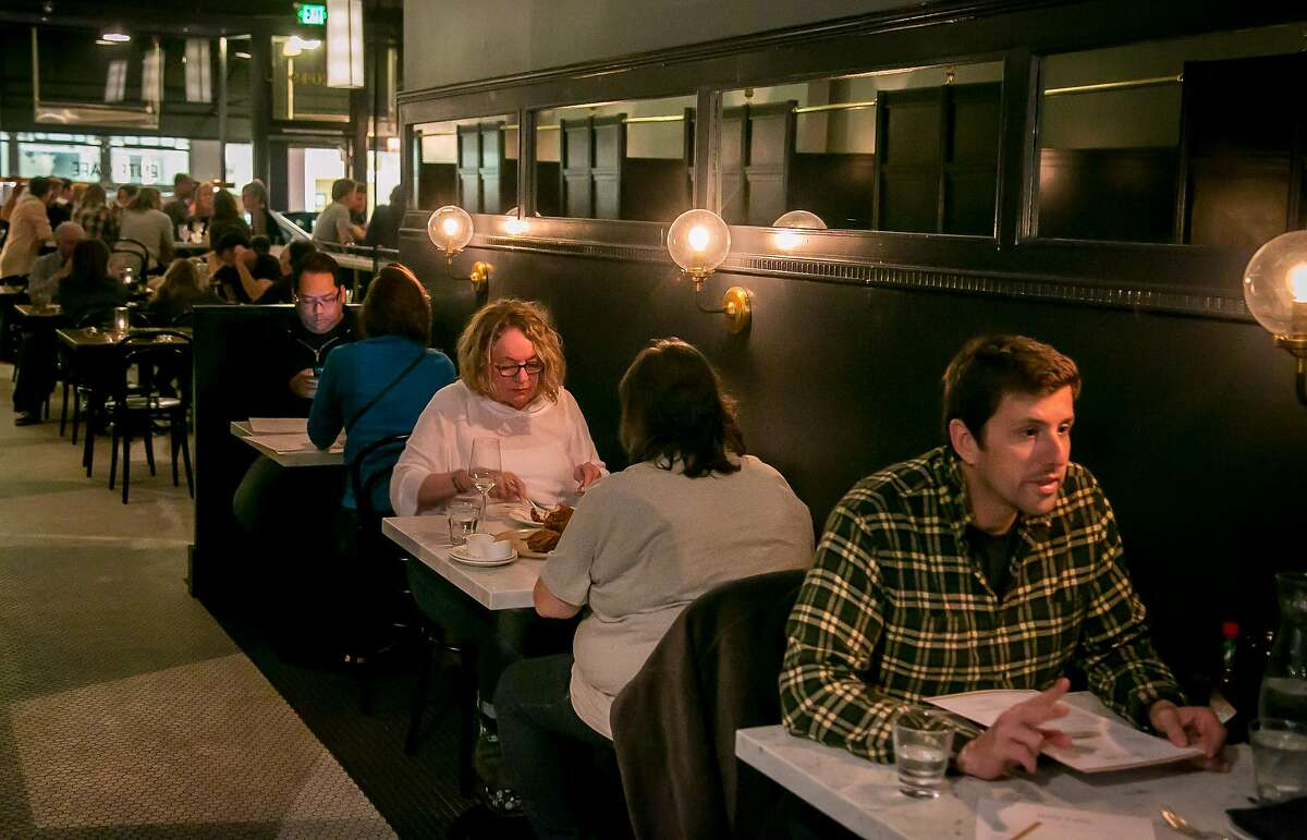 People have dinner at the Elite Cafe in San Francisco in 2016