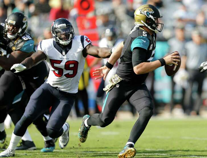 Jacksonville Jaguars quarterback Blake Bortles (5) is chased out of the pocket by Houston Texans outside linebacker Whitney Mercilus (59) during the second quarter of an NFL football game at Everbank Field on Sunday, Nov. 13, 2016, in Jacksonville.