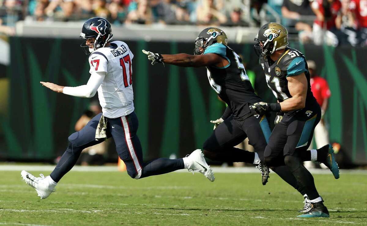 Houston Texans quarterback Brock Osweiler (17) is chased out of the pocket by Jacksonville Jaguars defensive end Dante Fowler (56) and middle linebacker Paul Posluszny (51) for a first down during the second quarter of an NFL football game at Everbank Field on Sunday, Nov. 13, 2016, in Jacksonville.