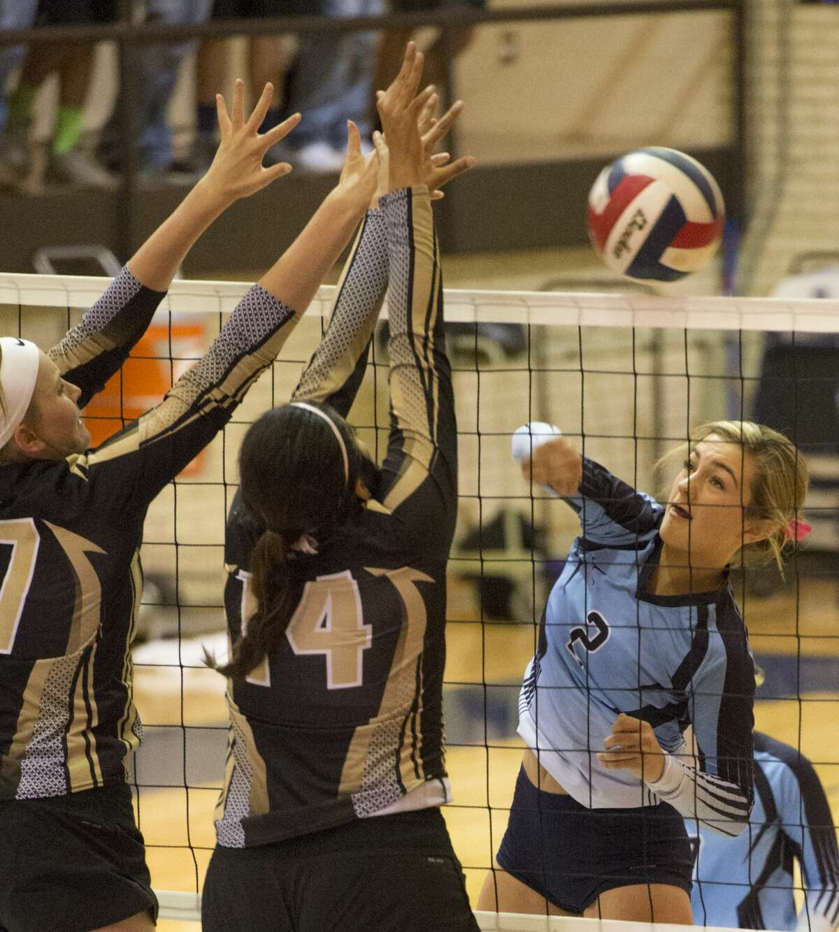 Andrews' Janey Leach, 17 and Laura Muniz, 14, combine for a block as Greenwood's Caity Payne hits Saturday 10-08-16 in Greenwood. Tim Fischer/Reporter-Telegram