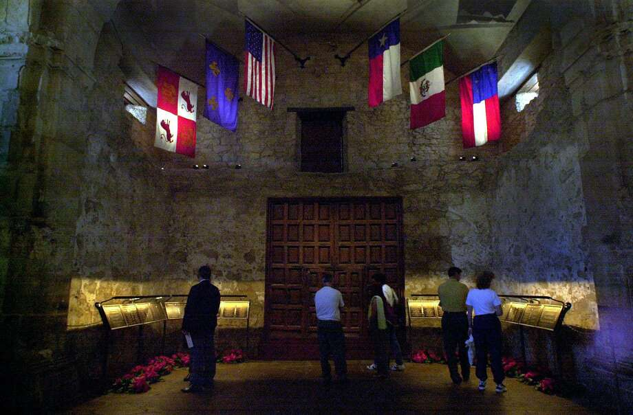 Visitors to the Alamo previewed a newly completed restoration of the mission church, after a ceremony held by the Daughters of the Republic of Texas in 2001. Fourteen plaques were removed from the wall inside the shrine to prevent deterioration and placed on stands. Photo: GLORIA FERNIZ /SAN ANTONIO EXPRESS-NEWS / SAN ANTONIO EXPRESS-NEWS