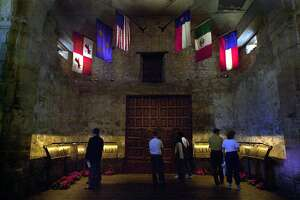 Visitors to the Alamo previewed a newly completed restoration of the mission church, after a ceremony held by the Daughters of the Republic of Texas in 2001. Fourteen plaques were removed from the wall inside the shrine to prevent deterioration and placed on stands.
