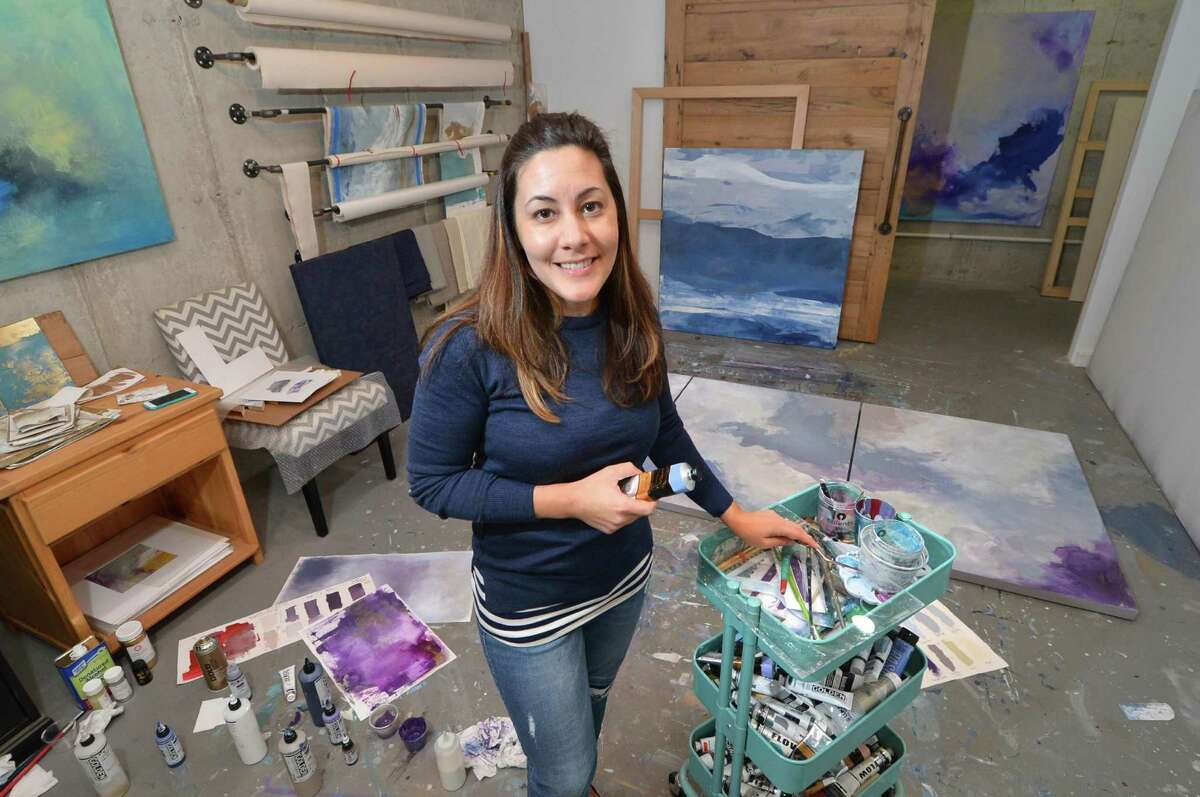 Artist Julia Contacessi with her paint trolley as she works on her latest Tryptik painting in her studio on Tuesday November 1, 2016 in Norwalk Conn