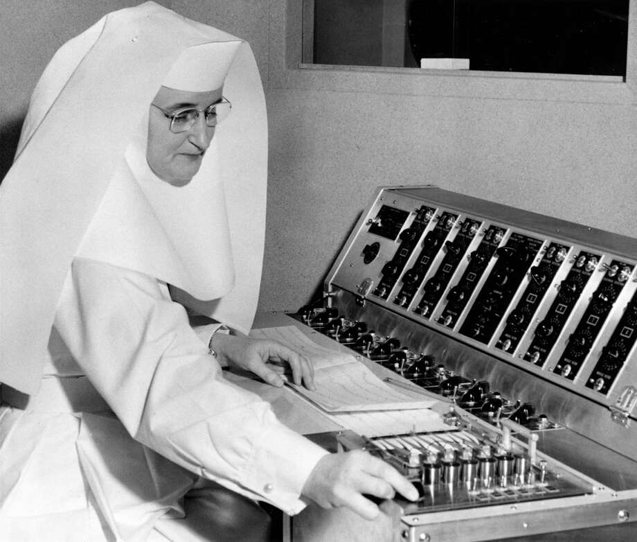 12/18/1954 - sister Anthony Marie studies a graphic record of electrical impulses within a human brain, recorded in the newly-opened department of electroencephalography at St. Joseph's Hospital. atterns obtained by the use of an electroencephalograph can be used in the diagnosis of epilepsy and other types of brain injury. Photo: Keith Hawkins, HP Staff / Houston Post files