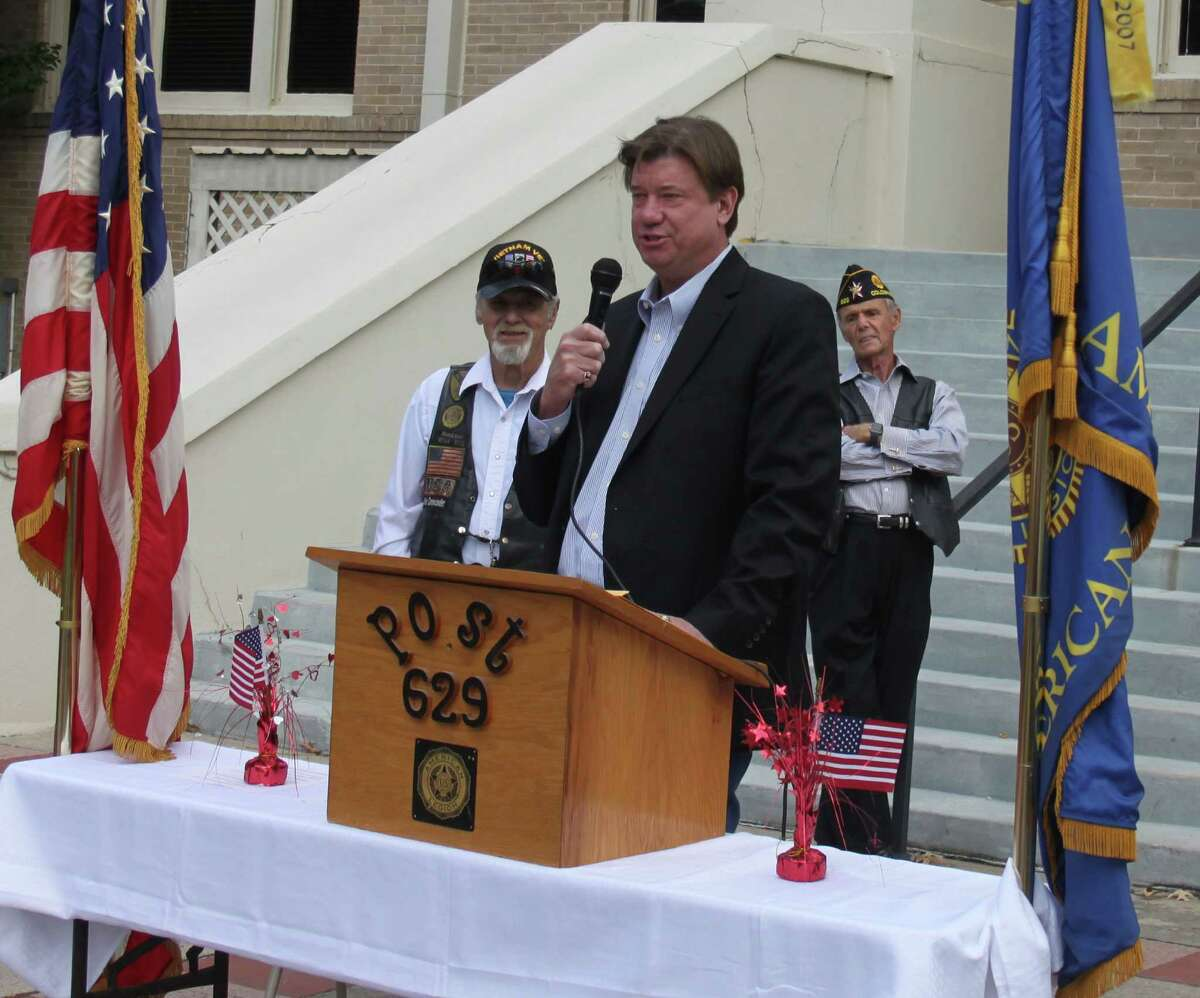 San Jacinto County Judge John Lovett gives a presentation for Veterans Day at the Coldspring courthouse alongside veterans of American Legion Post 629.