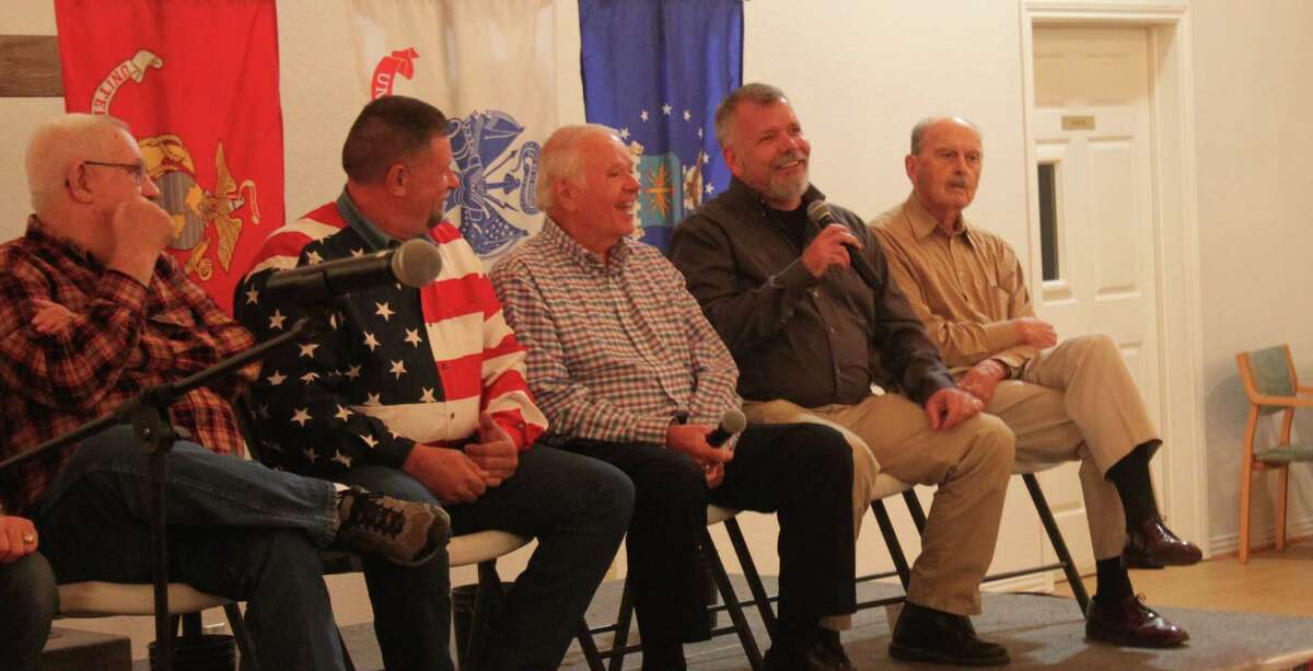 United States Army veteran Patrick Clark (second from right) describes some of his experiences in the military before the Coldspring United Methodist Church youth group known as the Matches on Nov. 9.