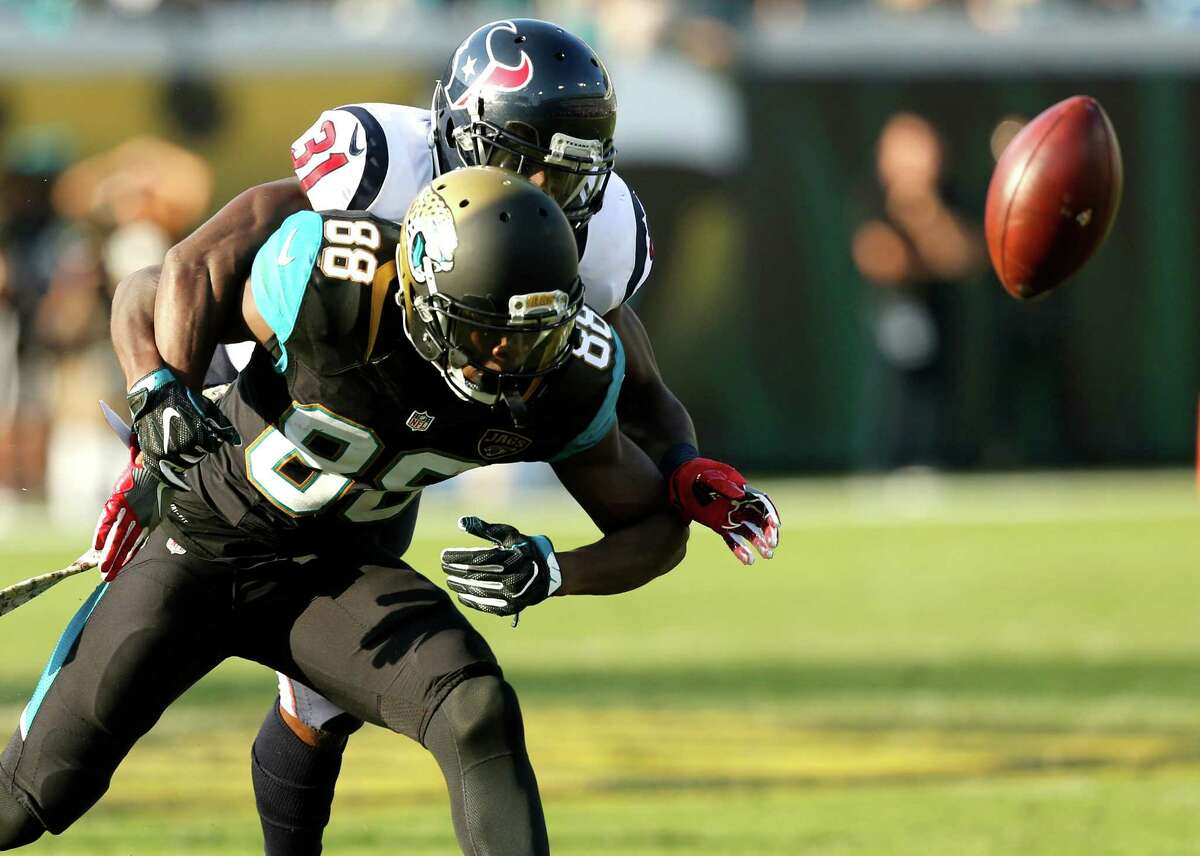Houston Texans defensive back Charles James (31) breaks up a pass intended for Jacksonville Jaguars wide receiver Allen Hurns (88) during the fourth quarter of an NFL football game at Everbank Field on Sunday, Nov. 13, 2016, in Jacksonville.