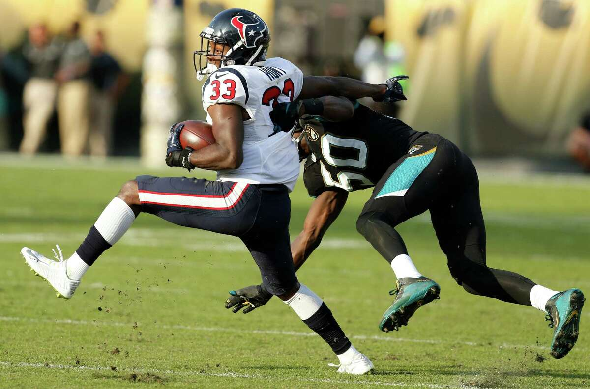 Houston Texans running back Akeem Hunt (33) is hit by Jacksonville Jaguars outside linebacker Telvin Smith (50) during the fourth quarter of an NFL football game at Everbank Field on Sunday, Nov. 13, 2016, in Jacksonville.