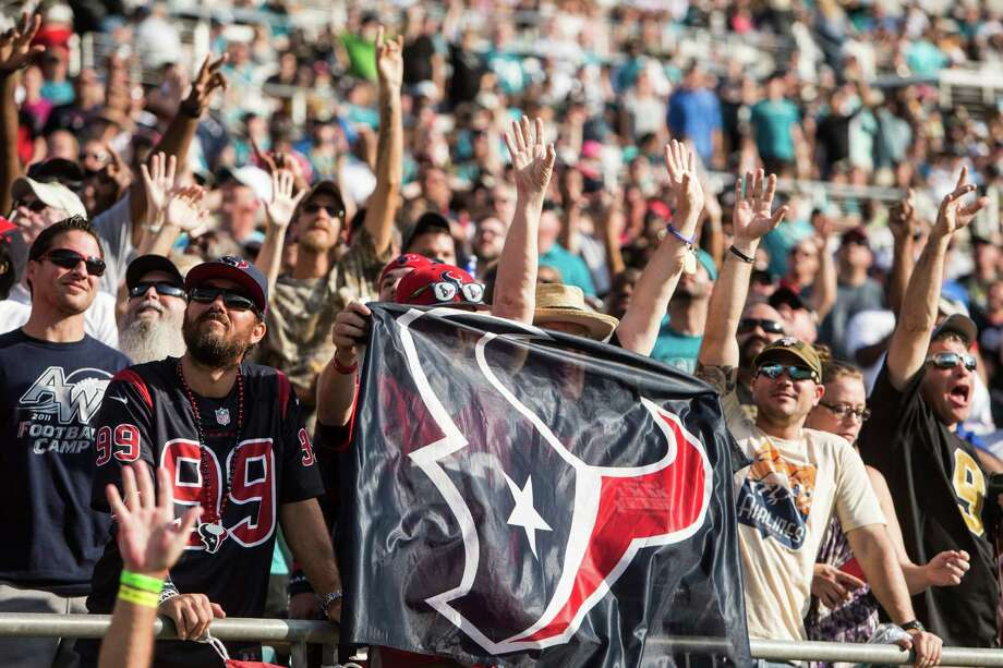 Houston Texans fans celebrate tight end Stephen Anderson's 7-yard touchdown reception against the Jacksonville Jaguars during the third quarter of an NFL football game at Everbank Field on Sunday, Nov. 13, 2016, in Jacksonville. Photo: Brett Coomer, Houston Chronicle / © 2016 Houston Chronicle