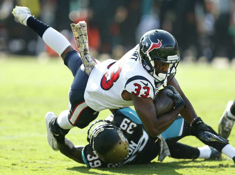 Houston Texans running back Akeem Hunt (33) is tackled by Jacksonville Jaguars free safety Tashaun Gipson (39) during the third quarter of an NFL football game at Everbank Field on Sunday, Nov. 13, 2016, in Jacksonville. Photo: Brett Coomer, Houston Chronicle / © 2016 Houston Chronicle