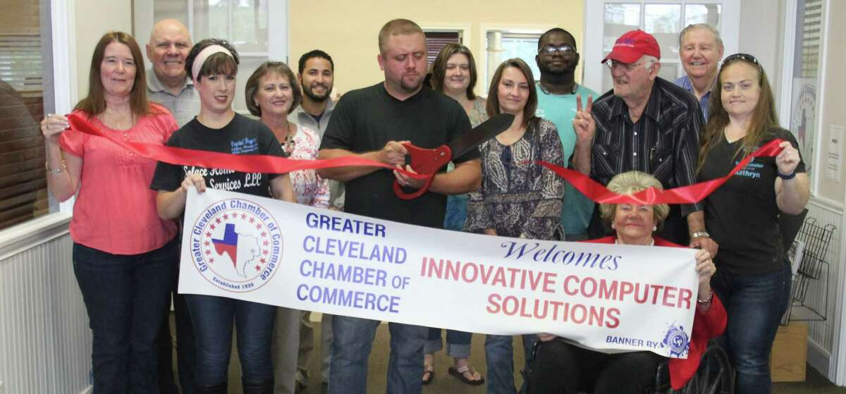 Jeremy Ewing cuts the ribbon to welcome his business, Innovative Computer Solutions, into the Greater Cleveland Chamber of Commerce on Nov. 9.