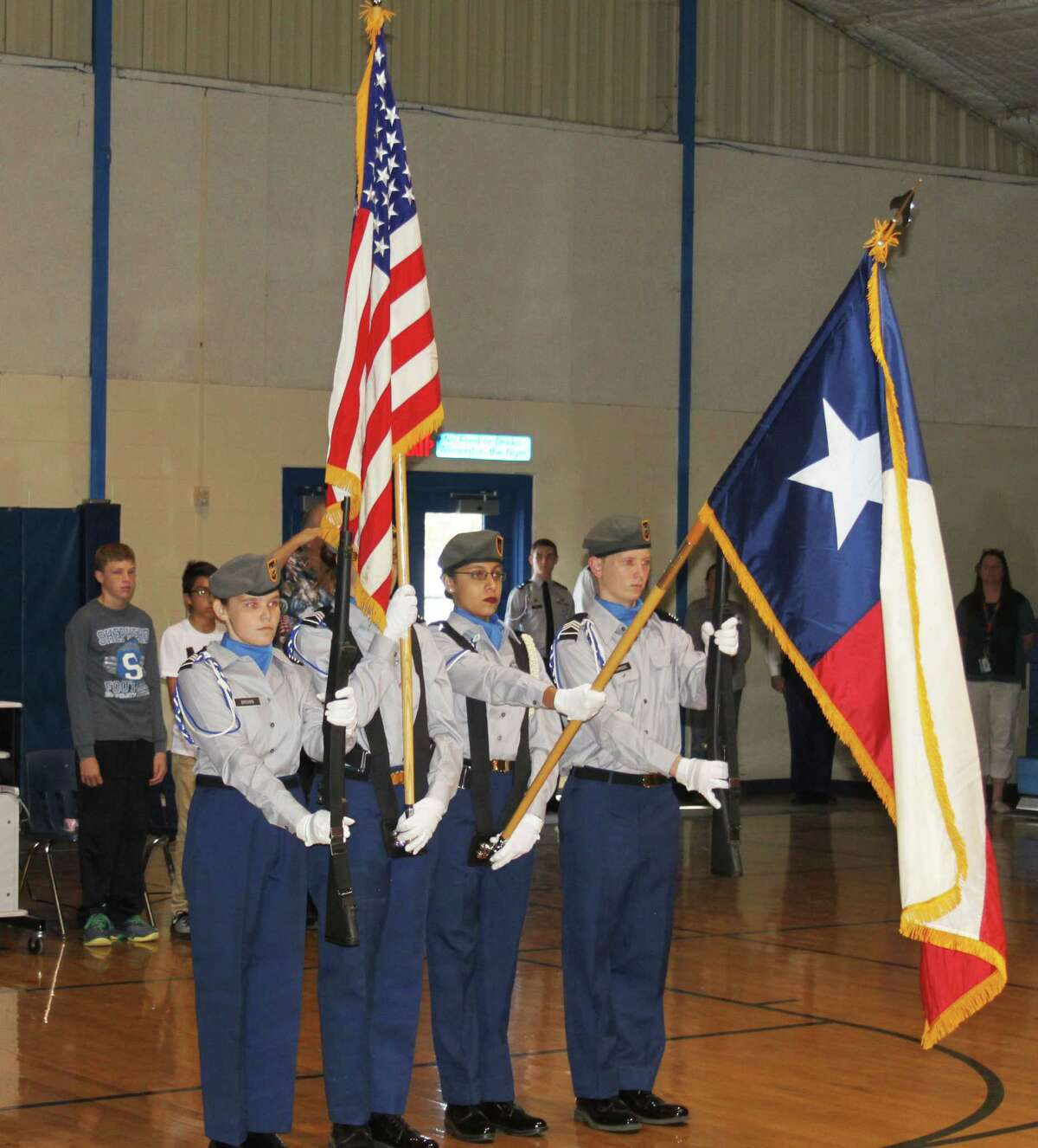 Cadets of Shepherd ISD JROTC present the United States and Texas flags at theShepherd Middle School gymnasiumfor the Veterans Day program.