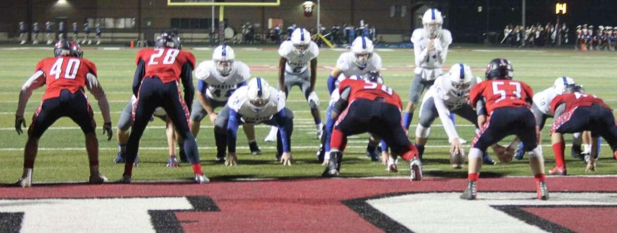 The Shepherd Pirates push the Hardin-Jefferson Hawks toward the end zone to make a touchdown.
