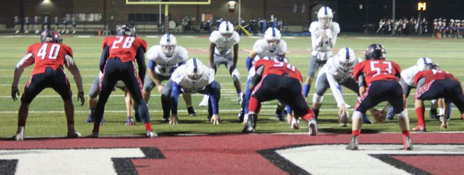 The Shepherd Pirates push the Hardin-Jefferson Hawks toward the end zone to make a touchdown. Photo: Jacob McAdams