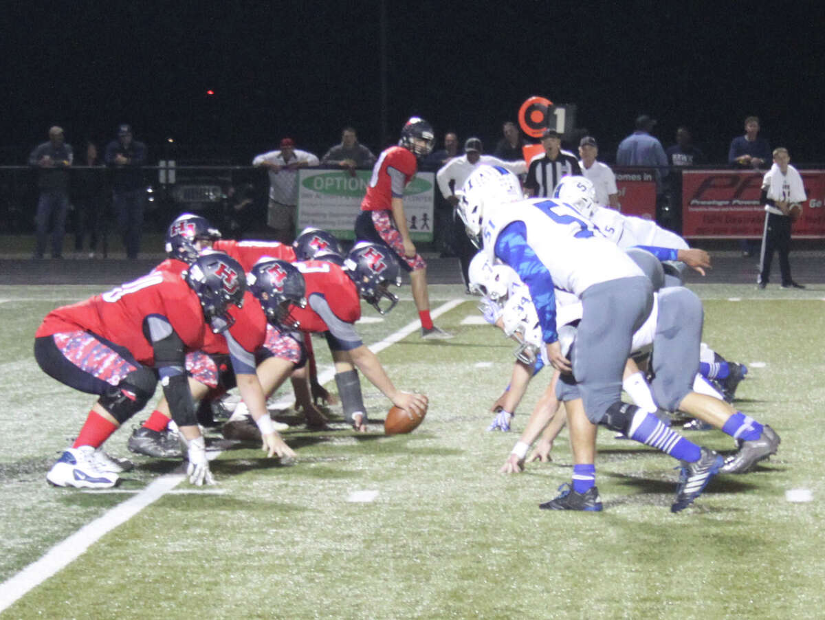 The Hardin-Jefferson Hawks (left) get ready to start their offensive against the Shepherd Pirates (right) during their playoff game on Nov. 11 held in Huffman, Texas.