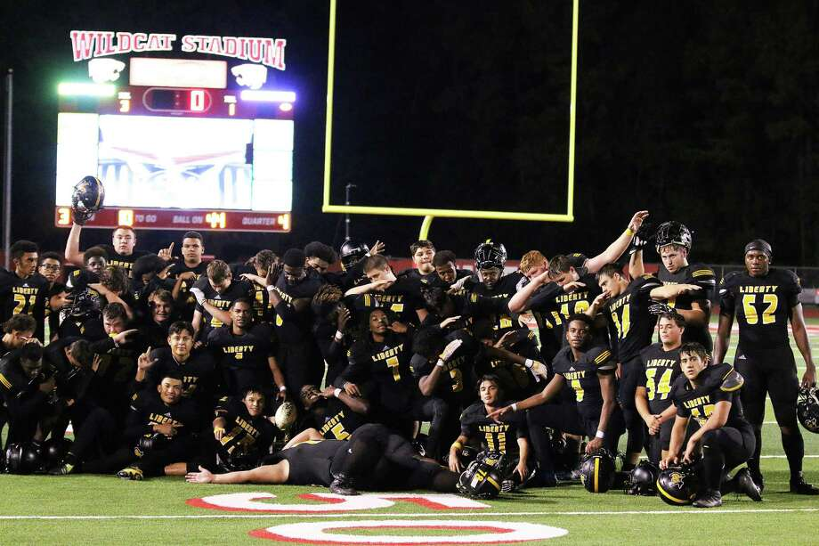 The Liberty Panthers do the Heisman pose following their first playoff victory in 12 years. They will face Lorena in College Station on Friday night. Photo: David Taylor