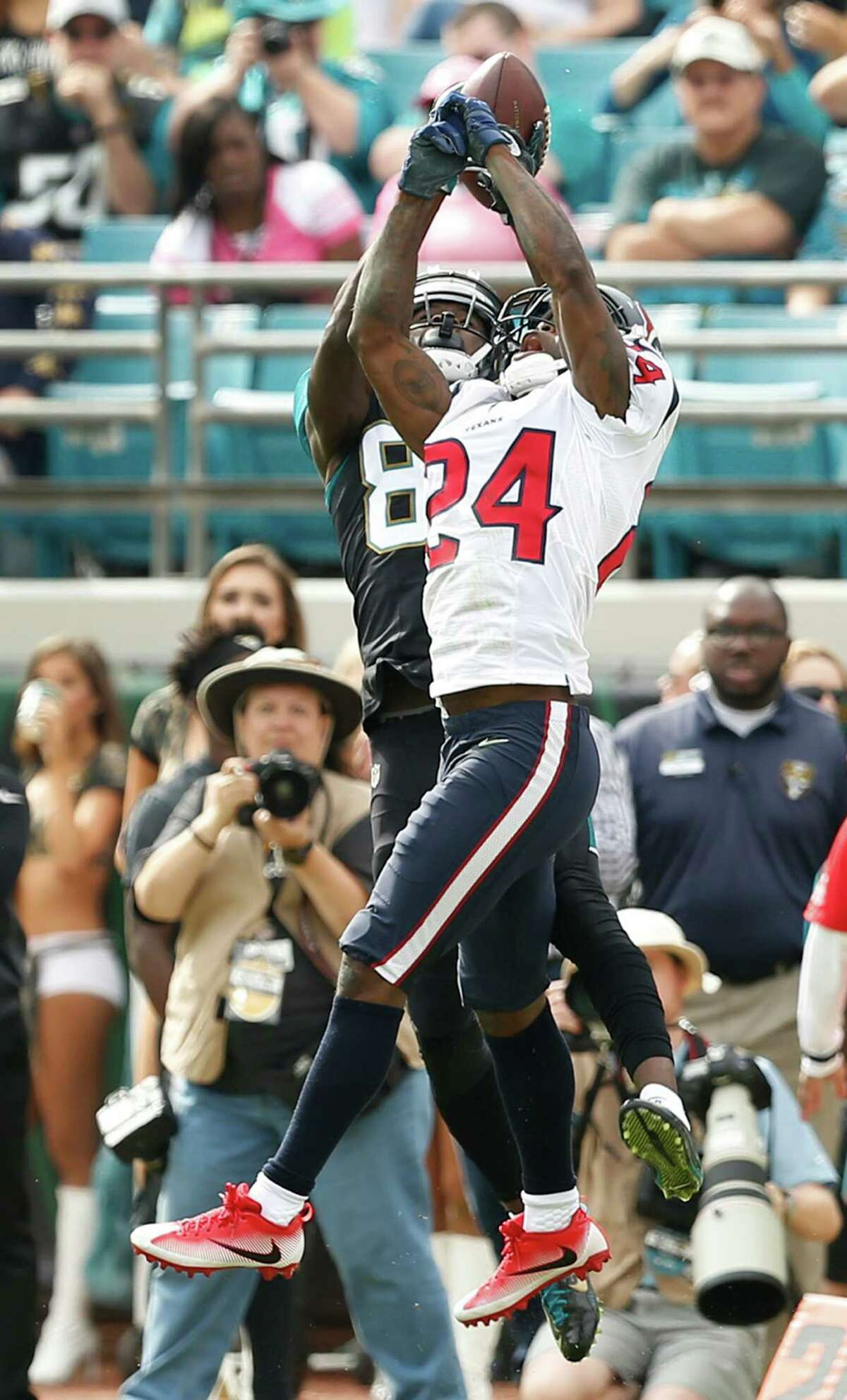 Houston Texans cornerback Johnathan Joseph (24) breaks up a pass intended for Jacksonville Jaguars wide receiver Allen Hurns (88) during the first quarter of an NFL football game at Everbank Field on Sunday, Nov. 13, 2016, in Jacksonville.