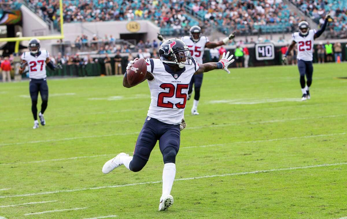 Houston Texans cornerback Kareem Jackson (25) returns an interception of a pass by Jacksonville Jaguars quarterback Blake Bortles for a 42-yard touchdown return during the first quarter of an NFL football game at Everbank Field on Sunday, Nov. 13, 2016, in Jacksonville.