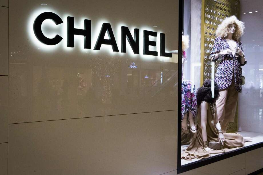 Art is playing a larger role in stores, as retailers do whatever they can to make shopping in person fun, inspiring and worth the time. The Chanel boutique in SoHo includes black-and-white paintings on aluminum panels from Robert Greene. Photo: Marie D. De Jesus /Houston Chronicle / © 2014 Houston Chronicle