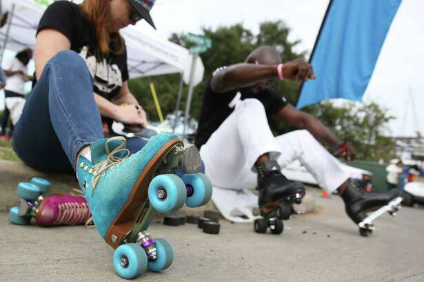 "Tawnya ""T"" King, left, and Leo ""Skate King"" Butler change roller skate wheels at Cigna Sunday Streets in Fifth Ward Sunday, Nov. 13, 2016, in Houston."