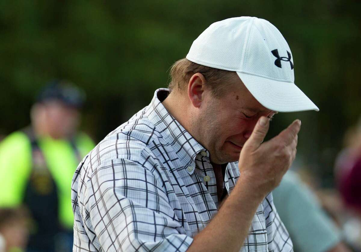 Robert Hamann, a U.S. Marine Corps veteran who served in the Golf War, becomes emotional as the Marines' Hymn is played during a Veterans Day celebration at Town Green Park Friday, Nov. 11, 2016, in The Woodlands.